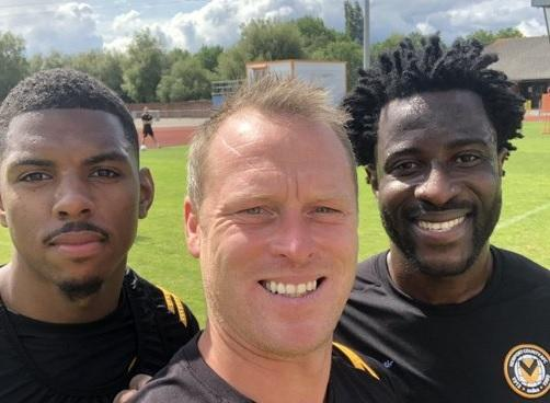 Campaign Series: TRAINING: Wilfried Bony, right, with Newport County boss Michael Flynn, centre, and Tristan Abrahams