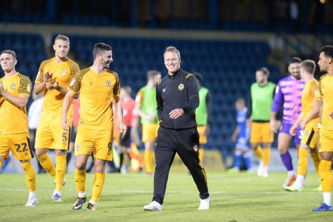 VICTORY: Newport County manager Michael Flynn and his players enjoyed their win at Gillingham in the Carabao Cup