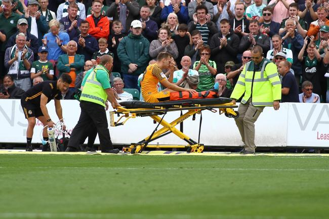 INJURED: Newport County defender Mickey Demetriou was stretchered off against Plymouth Argyle on Saturday