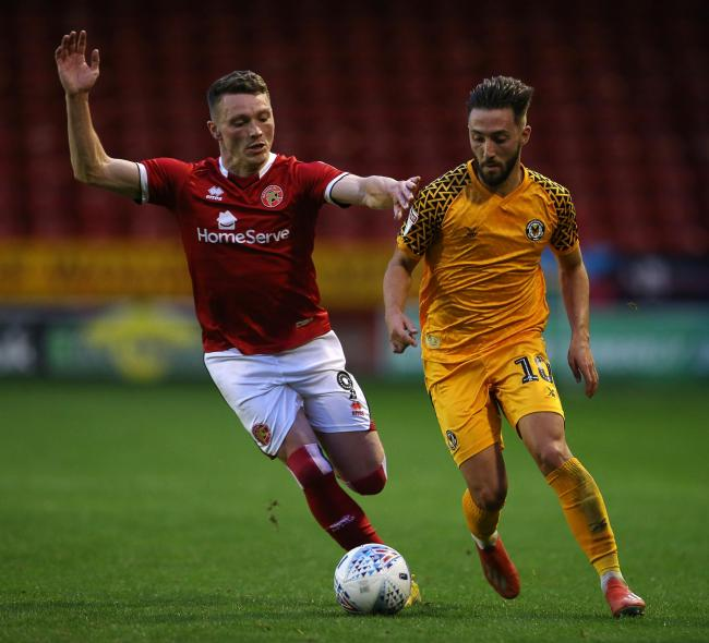 MAKING A STATEMENT: Newport midfielder Josh Sheehan, right