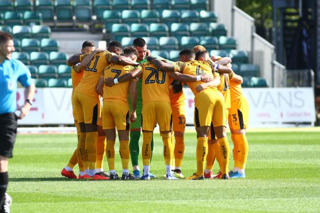 TOGETHER: The Newport County players in a pre-match huddle before Saturday's draw with Exeter City