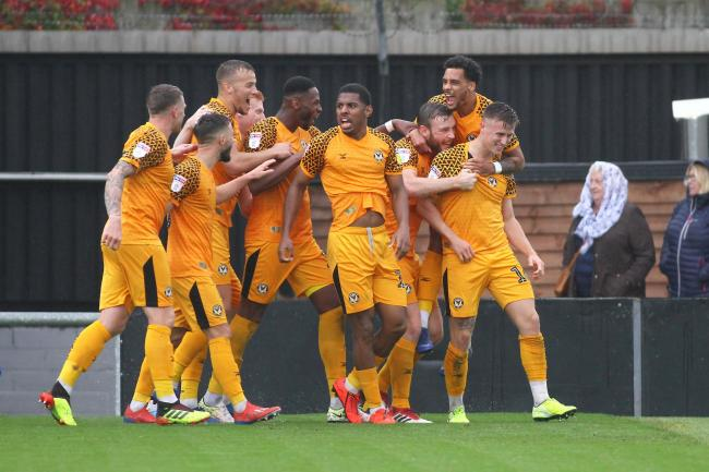 VICTORY: Newport County celebrate the late winner against Carlisle United from George Nurse, far right