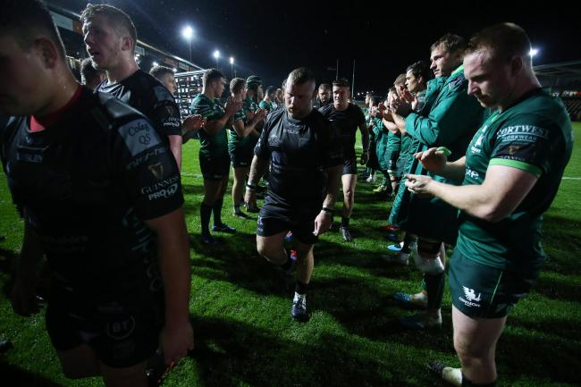DEJECTED: The Dragons leave the field after their hammering by Connacht