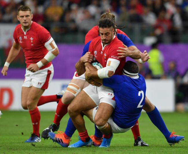 BLOW: Josh Navidi is tackled by Frances's Guilhem Guirado during the World Cup quarter-final at Oita Stadium. Picture: Ashley Western/PA Wire