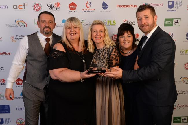 Skills Development Manager Tara Lane and representatives of Aspire Blaenau Gwent receive the Large Employer of the Year Award from Diane Block, regional manager of sponsor Babcock International Group
