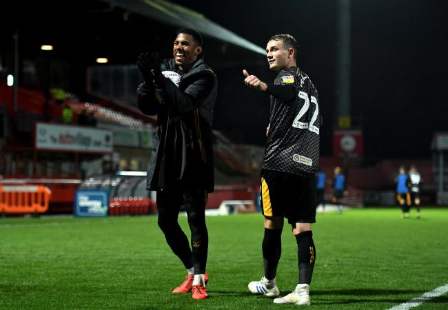 TRIUMPH: Newport County's hat-trick heroes Tristan Abrahams, left, and Taylor Maloney, right, celebrate at Cheltenham Town