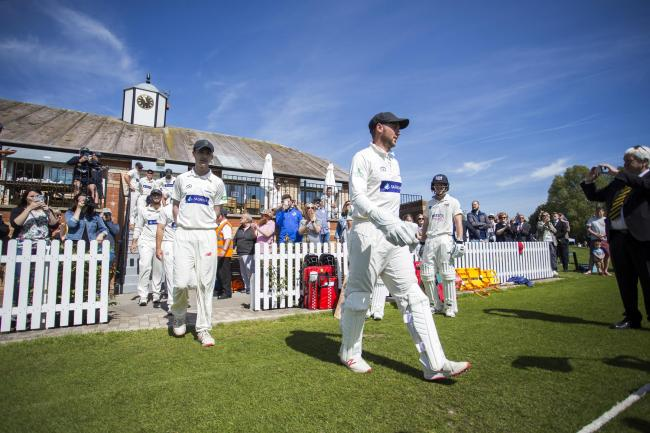SPYTTY RETURN: Glamorgan's players walk onto the Spytty Park pitch against Gloucestershire in May