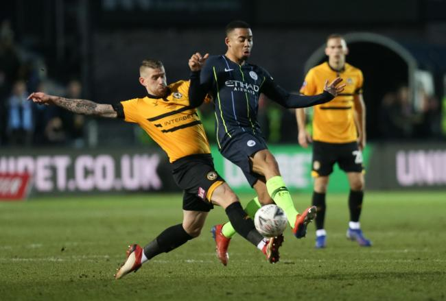 GONE: Scot Bennett, pictured tackling Manchester City's Gabriel Jesus, has left Newport County after the club couldn't offer a new deal