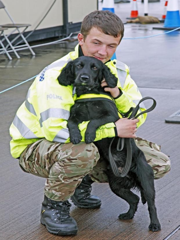 Sniffer dog Alvin, with his handler Cpl David Parton, 22, from Caerphilly