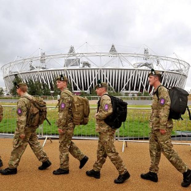 SPORTING DUTY: A group of soldiers march in front of the Olympic Stadium as they make their way to a security checkpoint at the Olympic Park entrances