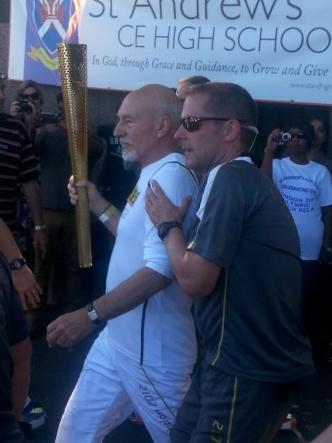 Sir Patrick Stewart carries the torch in to St Andrew's School Croydon