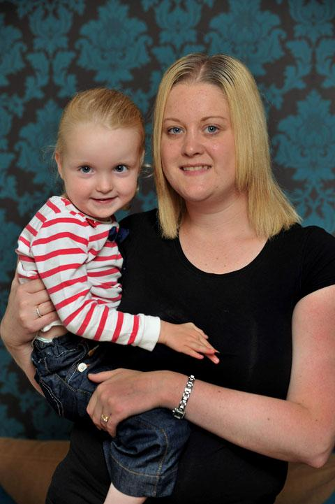 WALKING HELP: Olivia Robinson with mum Beth