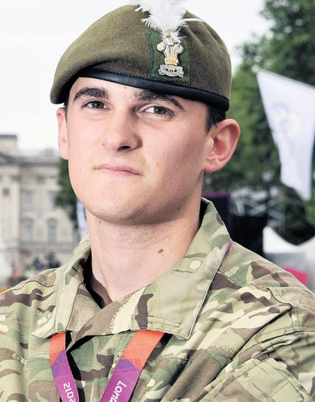 SECURITY ROLE: Private Sam Griffin who is working as part of the Olympics security team