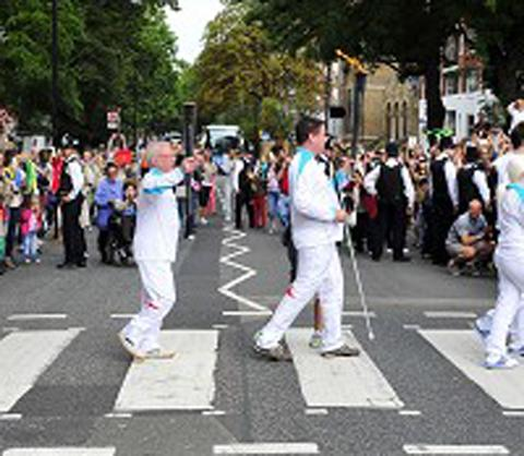 Paralympic torchbearers recreate the famous Beatles album cover at Abbey Road