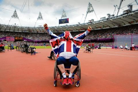 Delight – Robin Womack celebrates his bronze medal underneath the Union flag