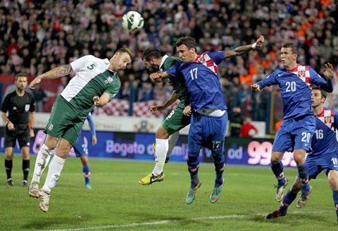 Darcy Blake, left, and Joe Ledley battle with Croatia's Mario Mandzukic