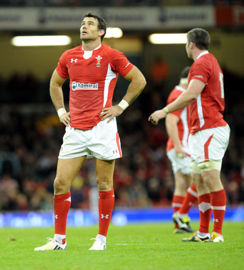 HEAVEN HELP US: Wales' Mike Phillips looks as if he is seeking divine inspiration
