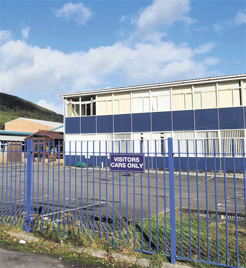 CWMCARN HIGH SCHOOL: Councillors tight-lipped as asbestos report is presented