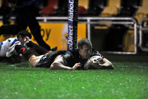 TRY TIME: Dragons centre Pat Leach crosses the line for the game's only touchdown
