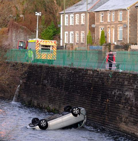 15FT PLUNGE: The upturned car in the river off Commercial Road in Machen