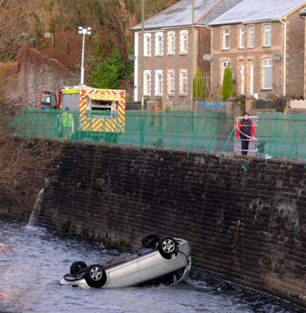 Campaign Series: 15FT PLUNGE: The upturned car in the river off Commercial Road in Machen