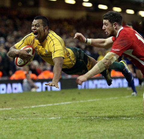AGONY: Australia's Kurtley Beale scores the try that snatched victory from Wales