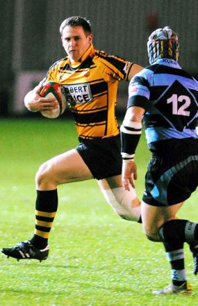 PACE: Newport's Adam Davies on the attack against Cardiff during tonight's derby clash at Rodney Parade