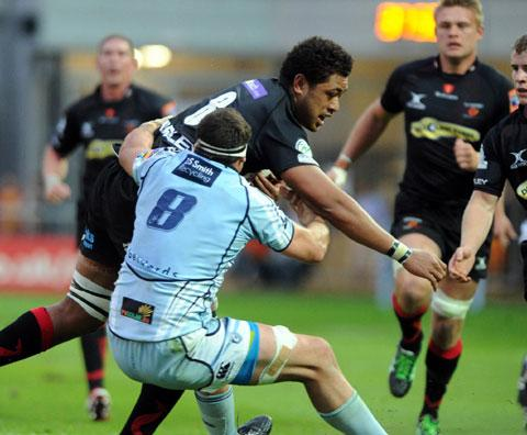 BATTLE: Andries Pretorius, shown here tackling Toby Faletau, is already familiar with Dragon Andrew Coombs