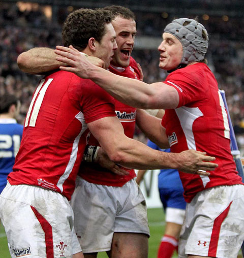 SPECIAL MOMENT: George North, left, celebrates his crucial try with Jamie Roberts and Jonathan Davies