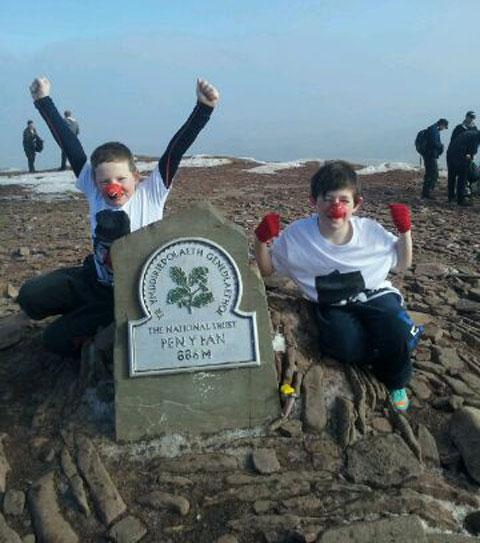 WE DID IT: Ashton Davies, eight, left, with his brother Kai, ten, on top of Pen y Fan