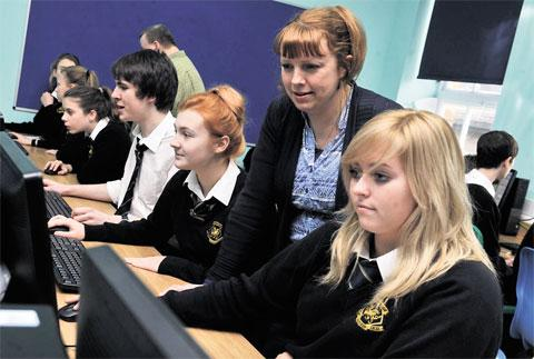 VALUABLE RESOURCE: Pupils try out the new ICT suite at Newbridge Comprehensive. Overseeing Key Stage 3 and 4 pupils is ICT head Jennette Williams