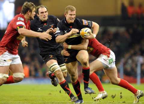 MILLENNIUM MAGIC: Pat Leach on the charge against the Scarlets last season