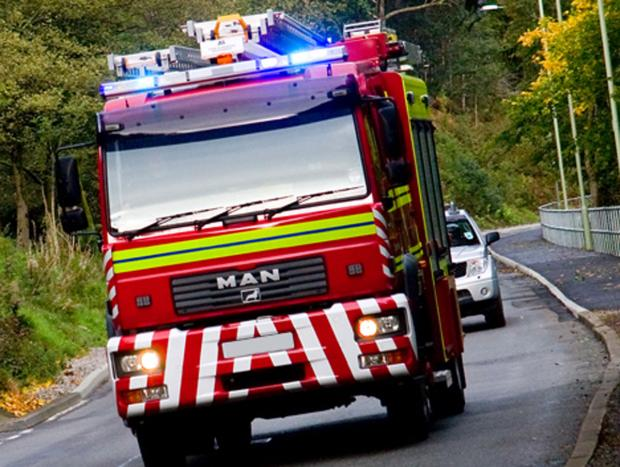Caerphilly club evacuated as firefighters battle bus