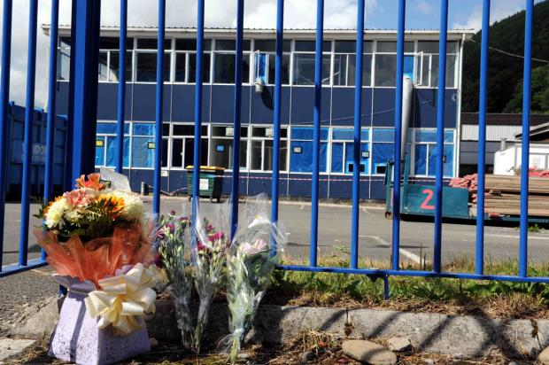 TRIBUTES: Flowers left outside Cwmcarn High School where James Paul of Abertillery was working