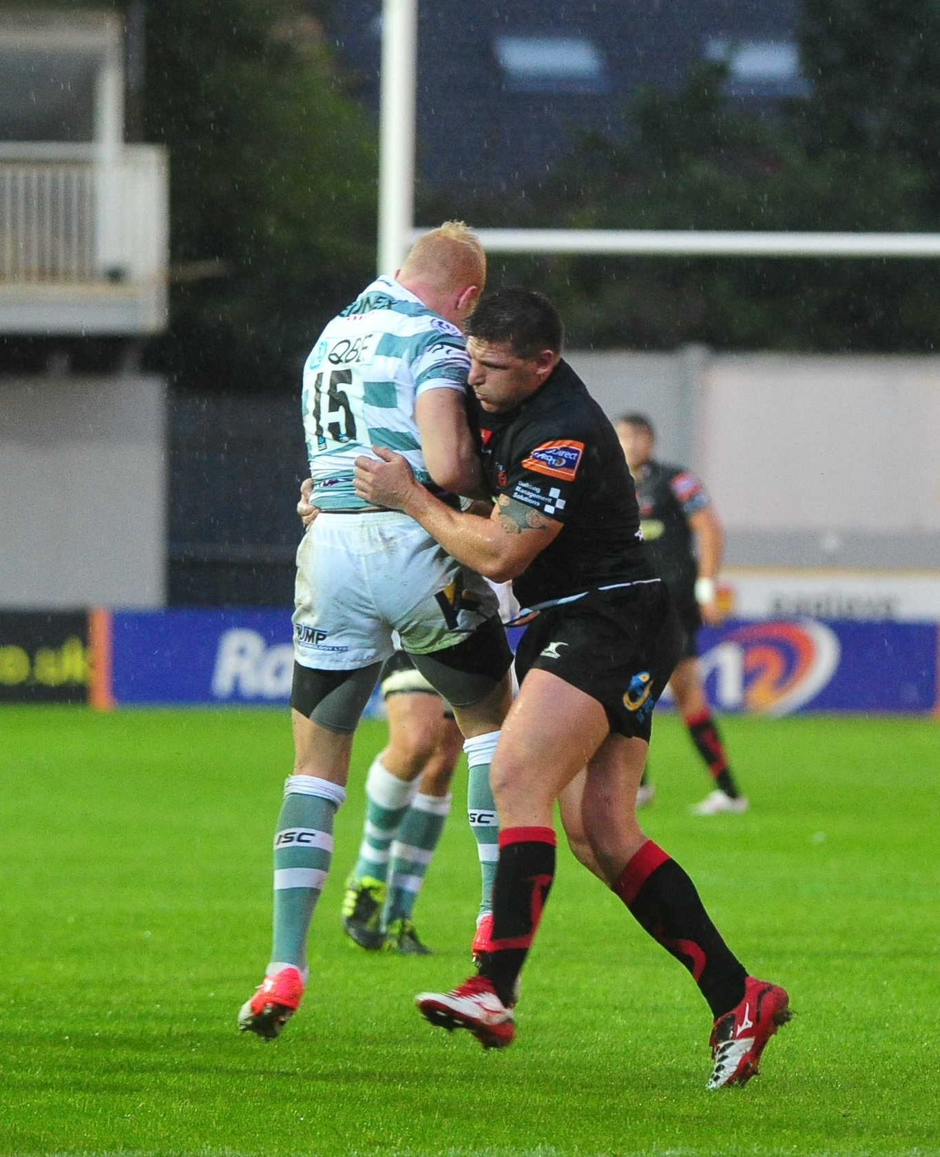 MM 17.8.12  NEWPORT GWENT DRAGONS V LONDON IRISH  PICTURED DARREN WATERS STOPS MATT GARVEY OF THE IRISH. (913327)