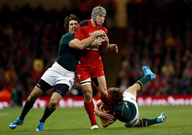 File photo dated 09/11/2013 of Wales' Jonathan Davies. PRESS ASSOCIATION Photo. Issue date: Tuesday November 12, 2013. PRESS ASSOCIATION Photo. Prop Adam Jones and centre Jonathan Davies have been ruled out of Wales' three remaining autumn Tests d