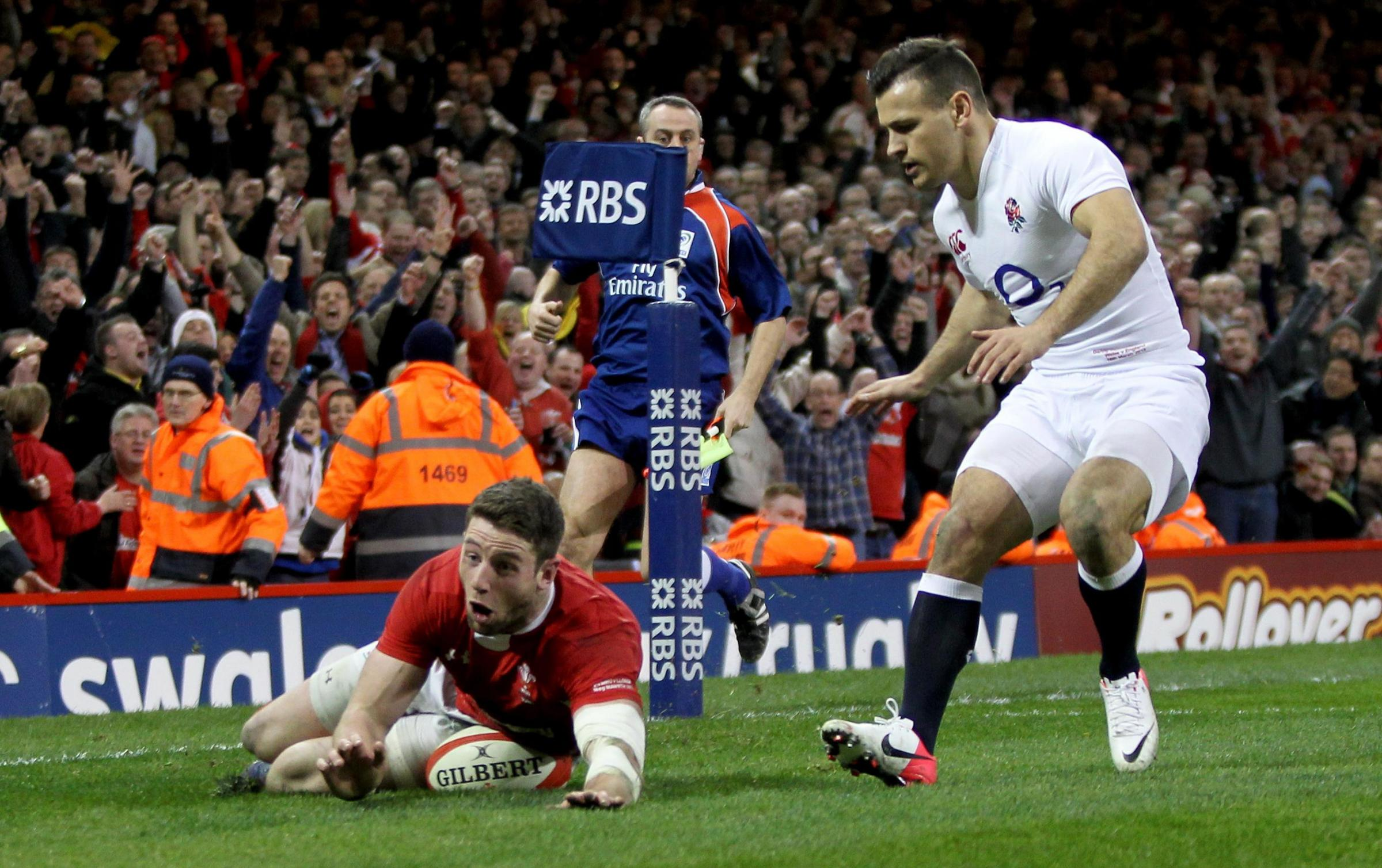 JUST CHAMPION: Alex Cuthbert scored two tries as Wales clinched the 2013 Six Nations title with victory over England