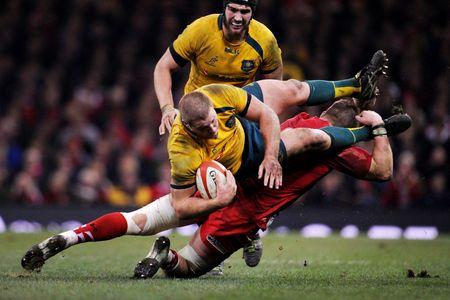 TOP OF THE CHOPS: Australia's James Slipper is tackled by Wales' Dan Lydiate