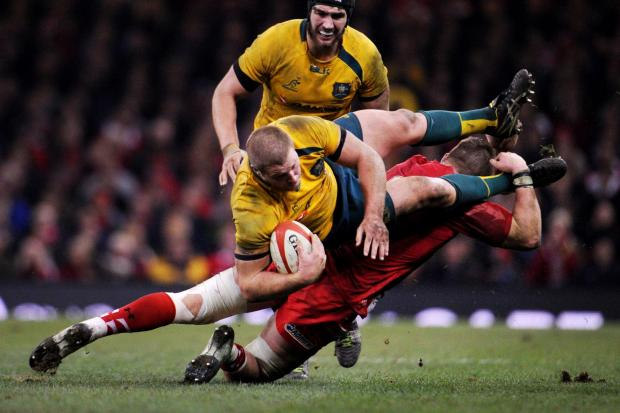 Campaign Series: TOP OF THE CHOPS: Australia's James Slipper is tackled by Wales' Dan Lydiate