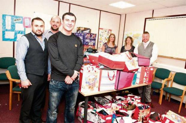 HO HO HO! Joe Calzaghe presented thousands of pounds worth of presents to Torfaen for We Fight Any Claim in Llantarnam