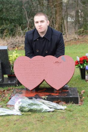 DISGUSTED: Ashley Davies at his father's desecrated grave