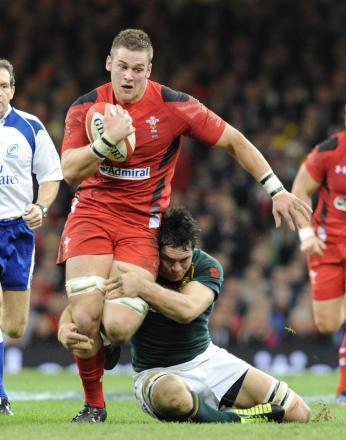 Dan Lydiate is tackled by Francois Louw (2397193)