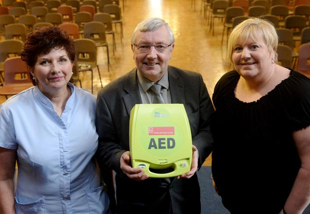 LIFE-SAVER: Head teacher Clive Jackson and staff members Dawn Hill (left) and Linda Collier who are trained in using heart defibrillators at West Monmouth school in Pontypool, one of just six seconday schools in Gwent with a defibrillator on site