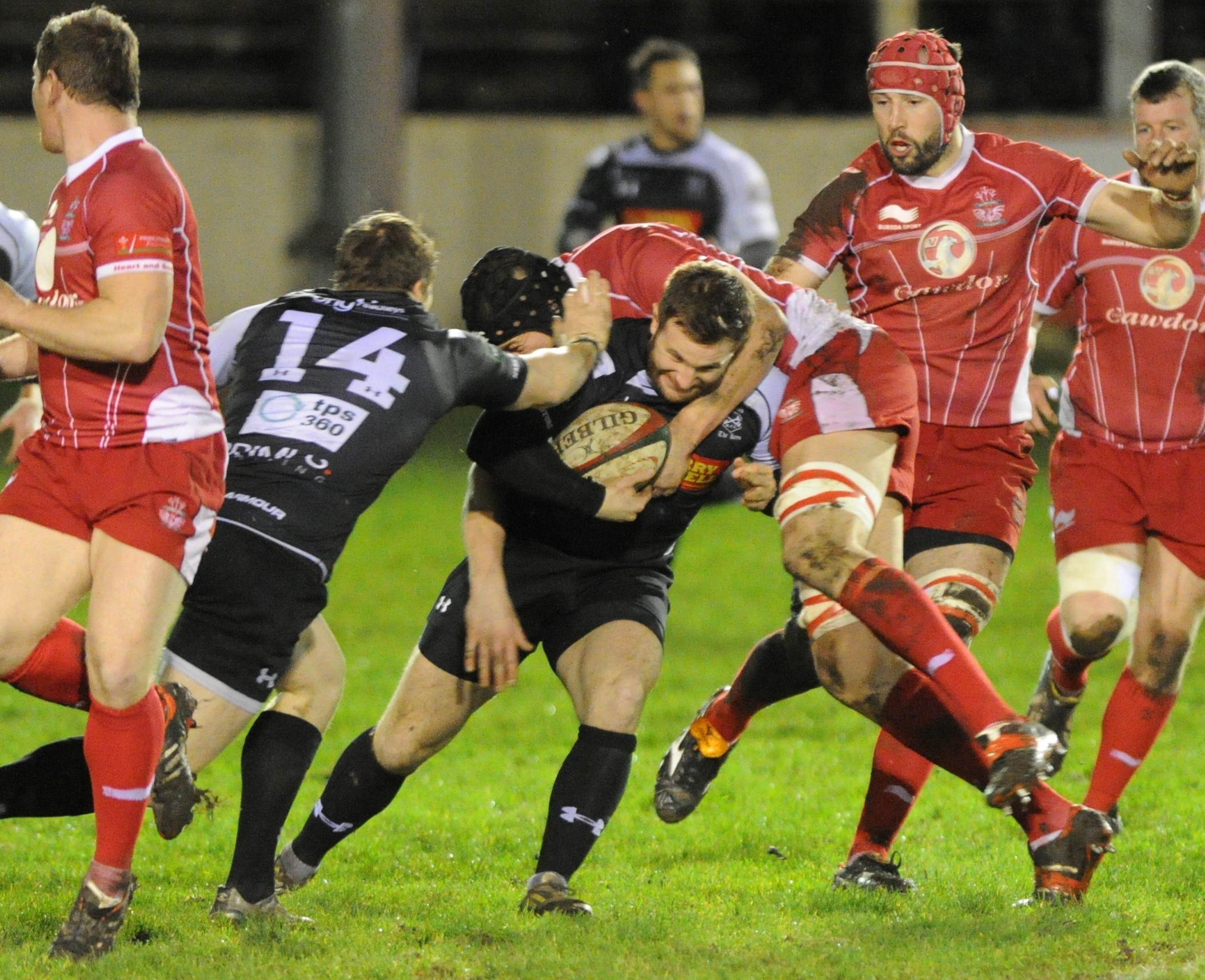 ON THE CHARGE: Cross Keys' Phil Williams takes on the Llanelli defence