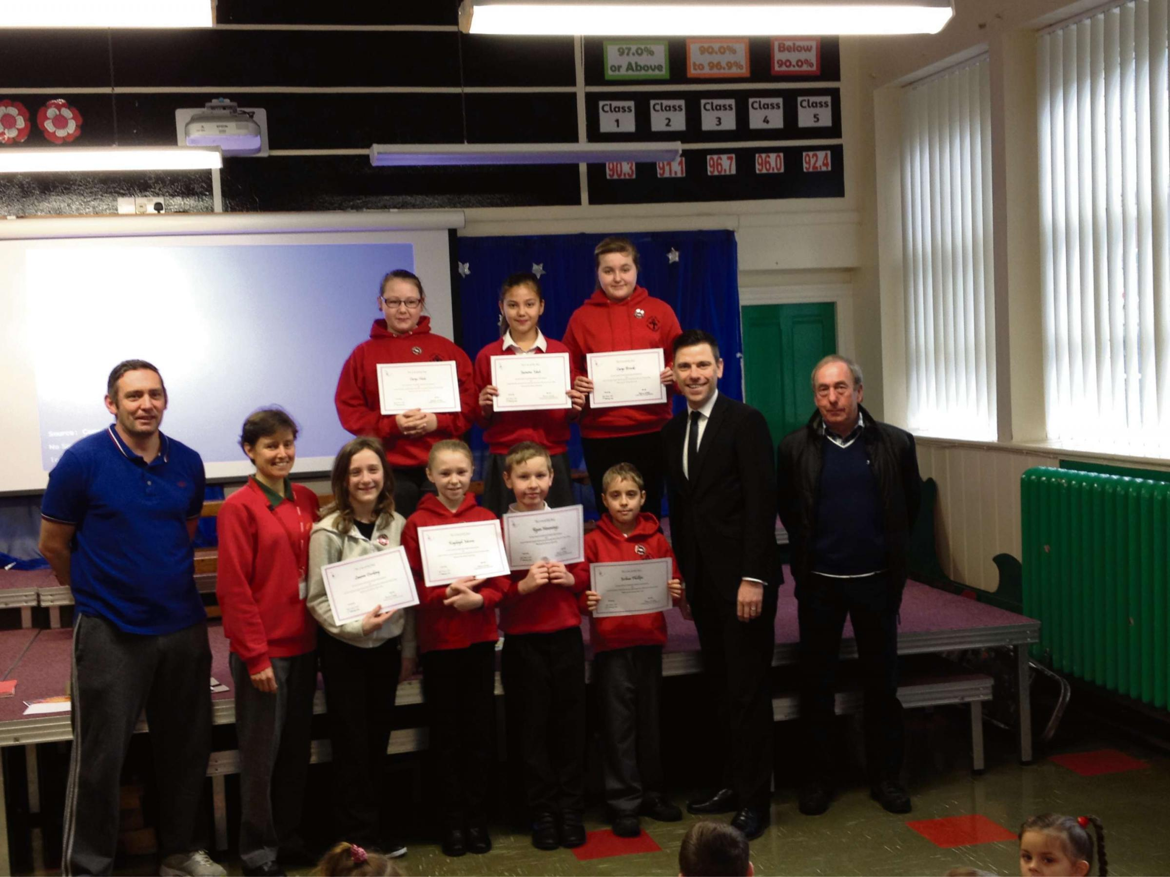 SAVERS: Islwyn MP Chris Evans with pupils at Fleur-de-Lys Primary School.