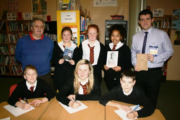 Campaign Series: BOOK: back (l-r) – author Phil Carradice, Leah Price, Shannon West, Jennifer Nibte-Dere and former pupil David Harris with the Risca Poetry anthology. Front (l-r) – Levin Gibson, Fern Price-Jones and Callum Bradbury.