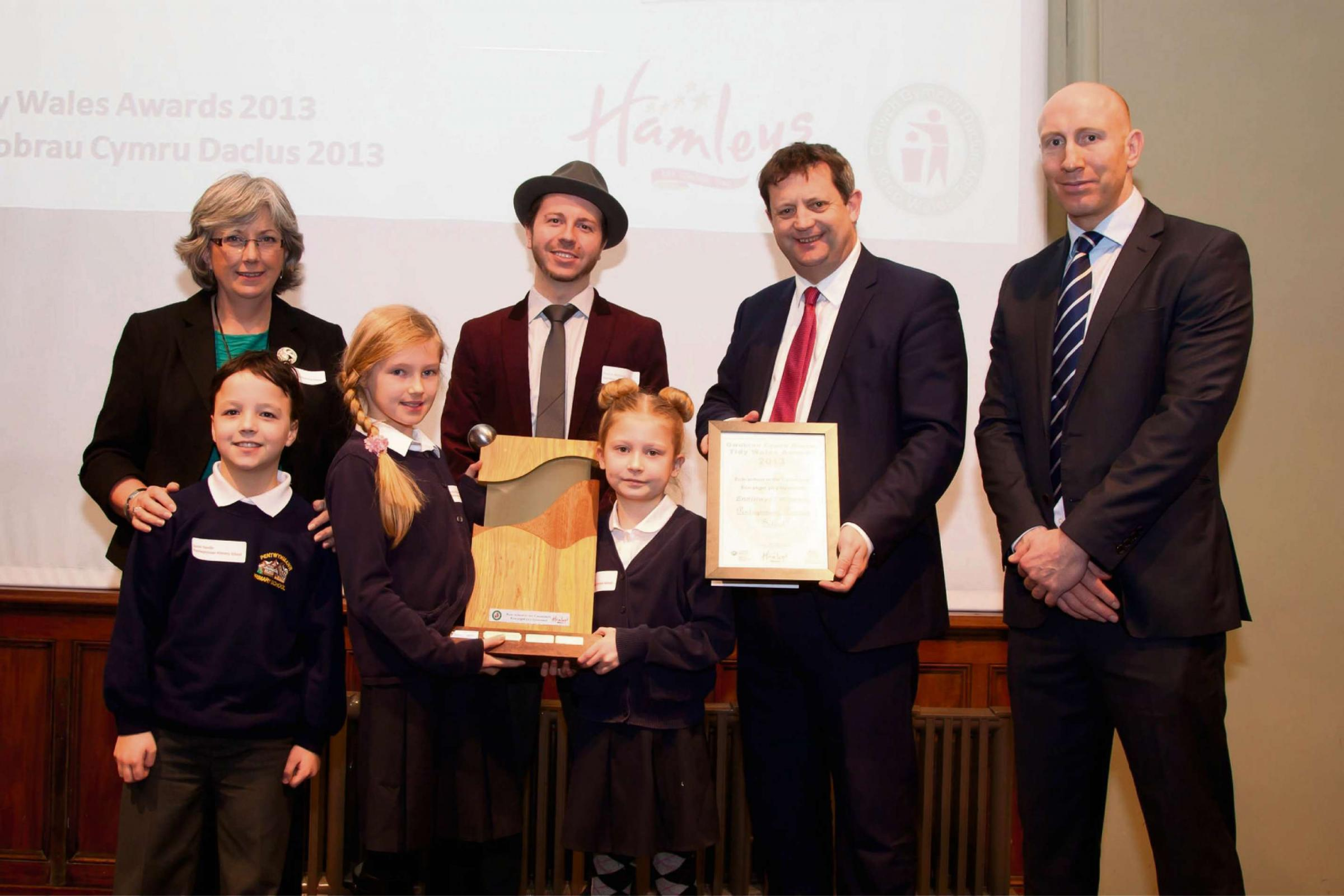 TIDY: Headteacher Jackie Nash, pupils Darcey Cheshire, Louis Yandle and Daisy Creed, Pearce Richards of Hamleys, Alun Davies AM and Tom Shanklin.
