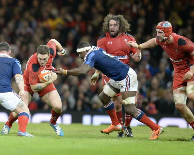 Campaign Series: BIG WIN: Adam Jones, centre, watches on as George North goes for the gap against France