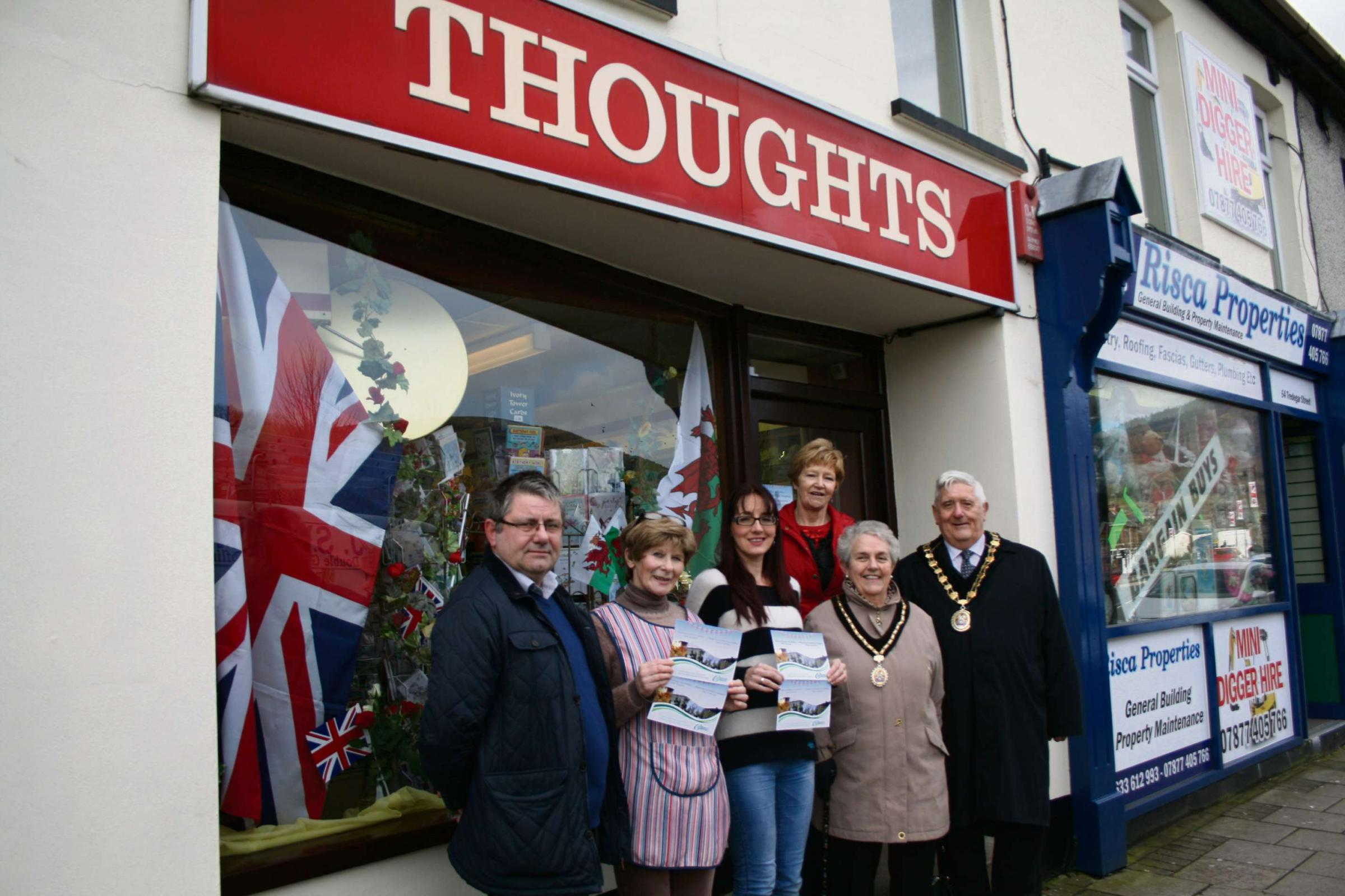 WINNERS: Thoughts employees Chris Arkell and Julia Lee celebrate winning the 'Dress your Shop' competition with Cllr Nigel George, Cllr Hazel Dupre, Mrs Ruth Gray and mayor of Caerphilly, Cllr Michael Gray.