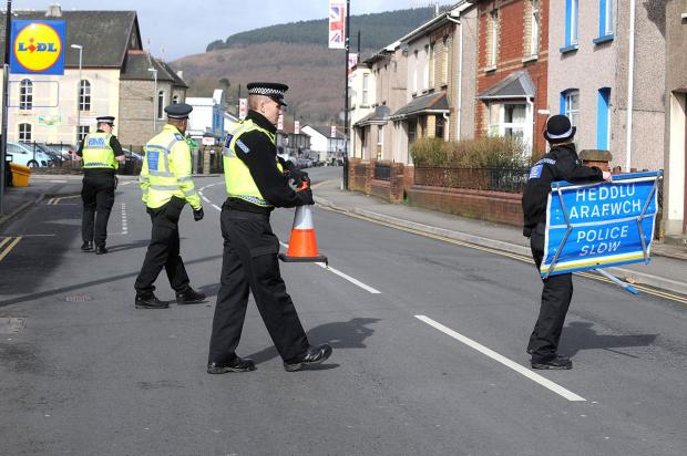 SCENE: Police set up a cordon following the bomb alert in Risca on Tuesday
